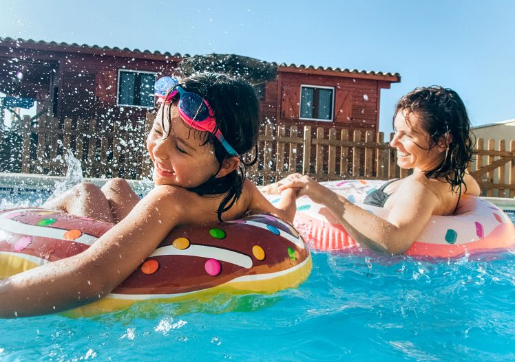 child-woman-pool-float-stocksy.jpg