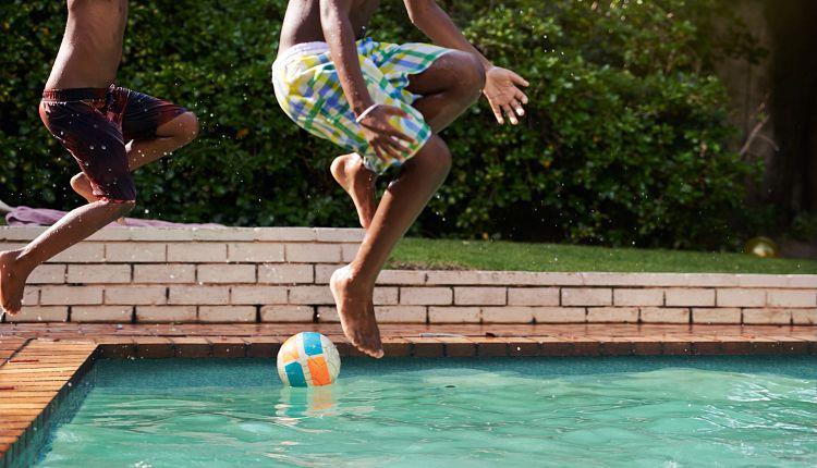 two-kids-jumping-pool.jpg