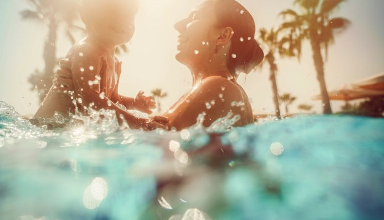 moments-woman-with-child-pool-istock-1133873375.jpg