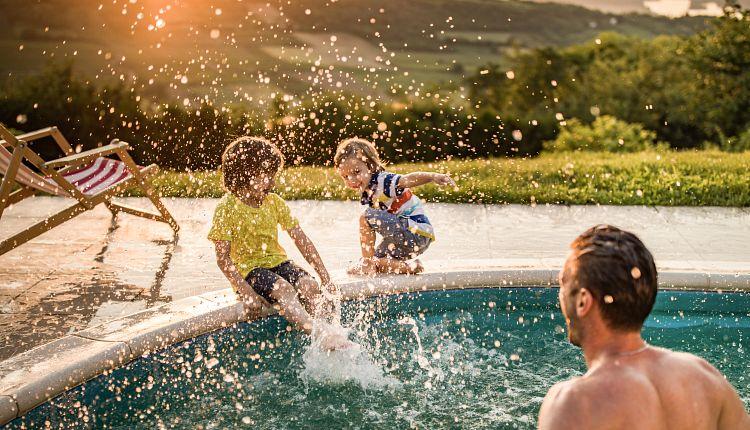 moments-children-splashing-poolside-adult.jpg