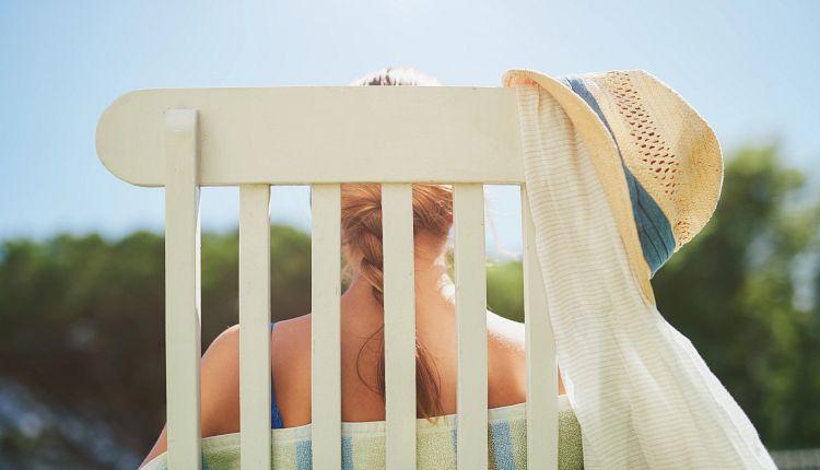 woman-white-chair-poolside.jpg