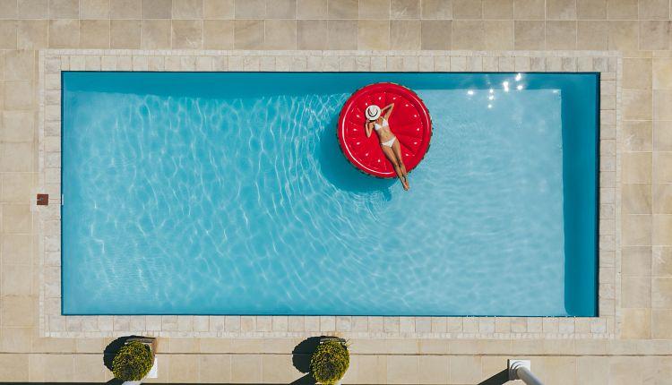 overhead-woman-red-round-float-pool.jpg