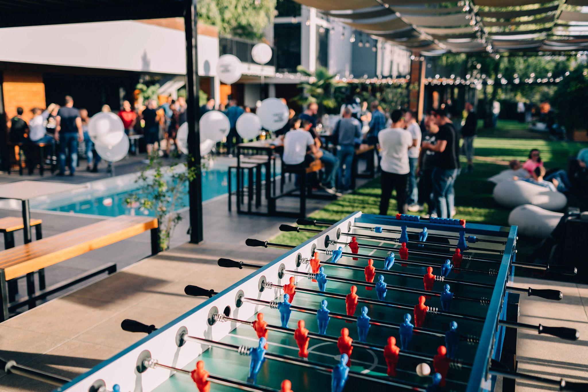 fooseball-table-adults-pool-party-globes-stocksy_txp6a6d40e3hbj200_originaldelivery_2775949.jpg